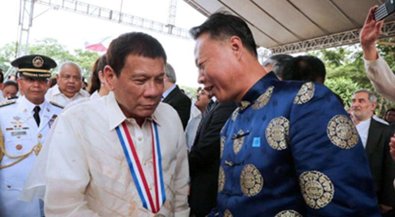 President Rodrigo Duterte shakes hands with Chinese Ambassador to the Philippines Zhao Jianhua. Photo: EPA